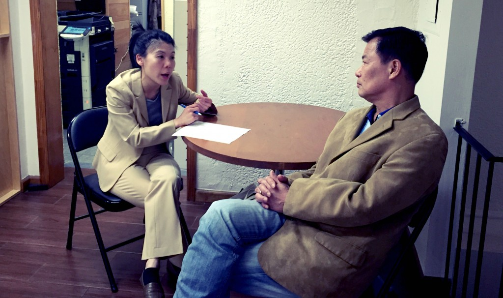 Donna Chiu, Director of Housing and Community Services counseling a client.